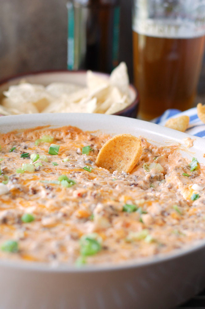 Hot Sausage Beer Cheese Dip with a chip
