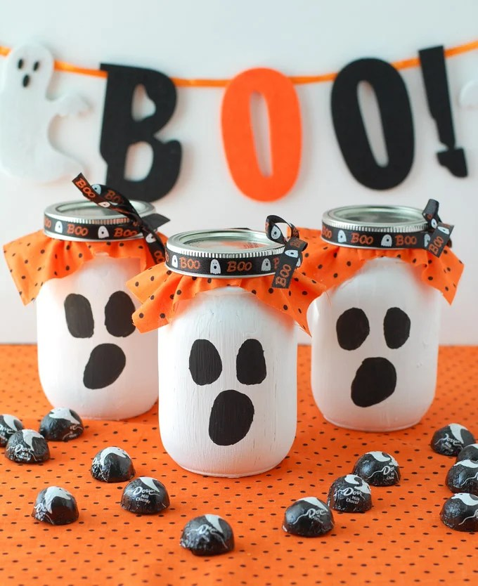 3 ghost mason jars with candy