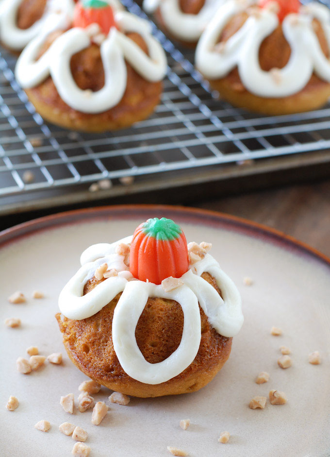 Pumpkin toffee mini bundt cakes are a delicious way to celebrate fall. Pumpkin cake filled with toffee chips and topped with buttercream icing.
