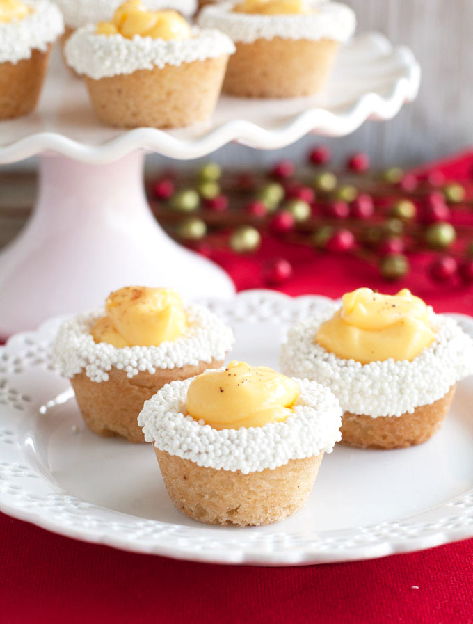 Sugar cookie dough baked in a mini muffin pan and topped with eggnog pudding make these eggnog cookie cups a delicious holiday treat.