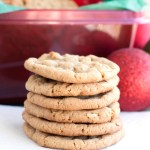 Stack of cookies with red ornament.