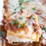 Spatula with piece of lasagna.