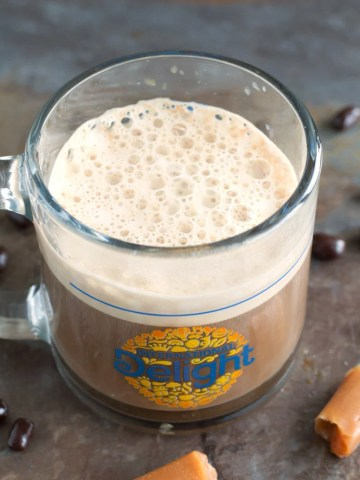 Mug filled with coffee.