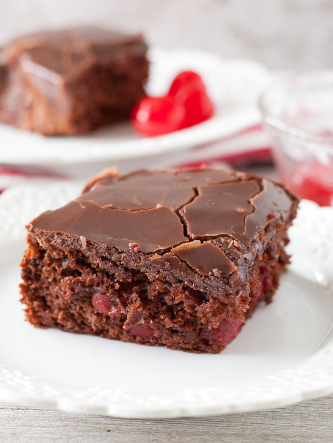 Easy chocolate cherry cake is a moist and delicious chocolate cake filled with cherries and topped with chocolate ganache.