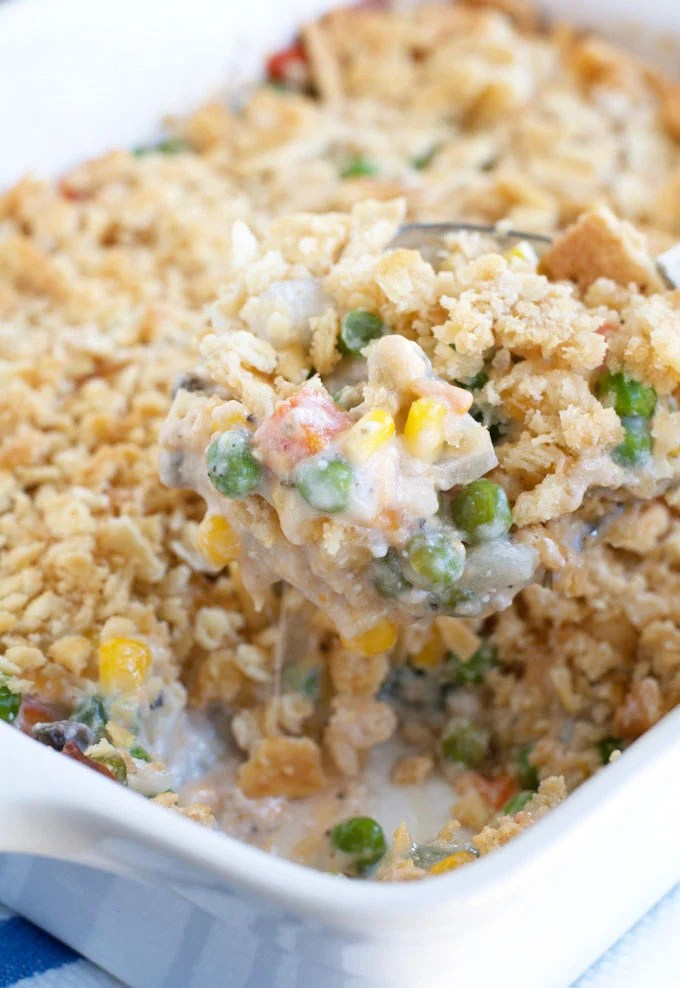 Cheesy Vegetable Casserole is a crowd favorite. The ultimate side dish filled with veggies, cheese, and topped with crushed buttery crackers.