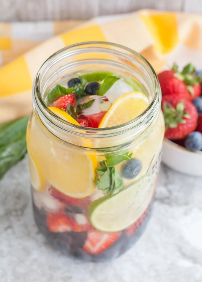 Rainbow Detox Water full of fruit and fresh basil