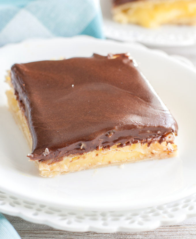 A piece of eclair cake on white plate