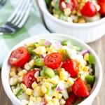 Two bowls of corn salad.
