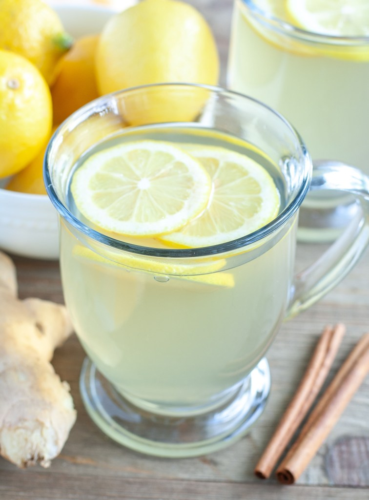 Mug of ginger tea and lemon