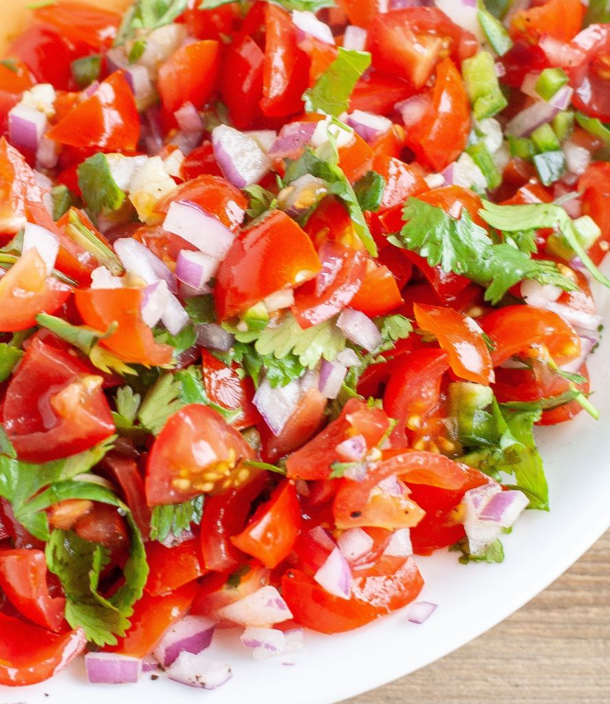 Pico de gallo in a white bowl