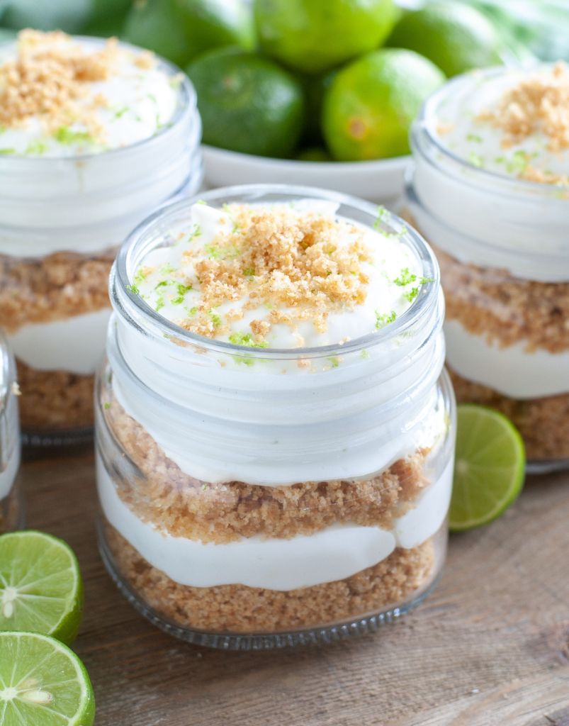 3 jars of key lime trifles. Key limes around the jars