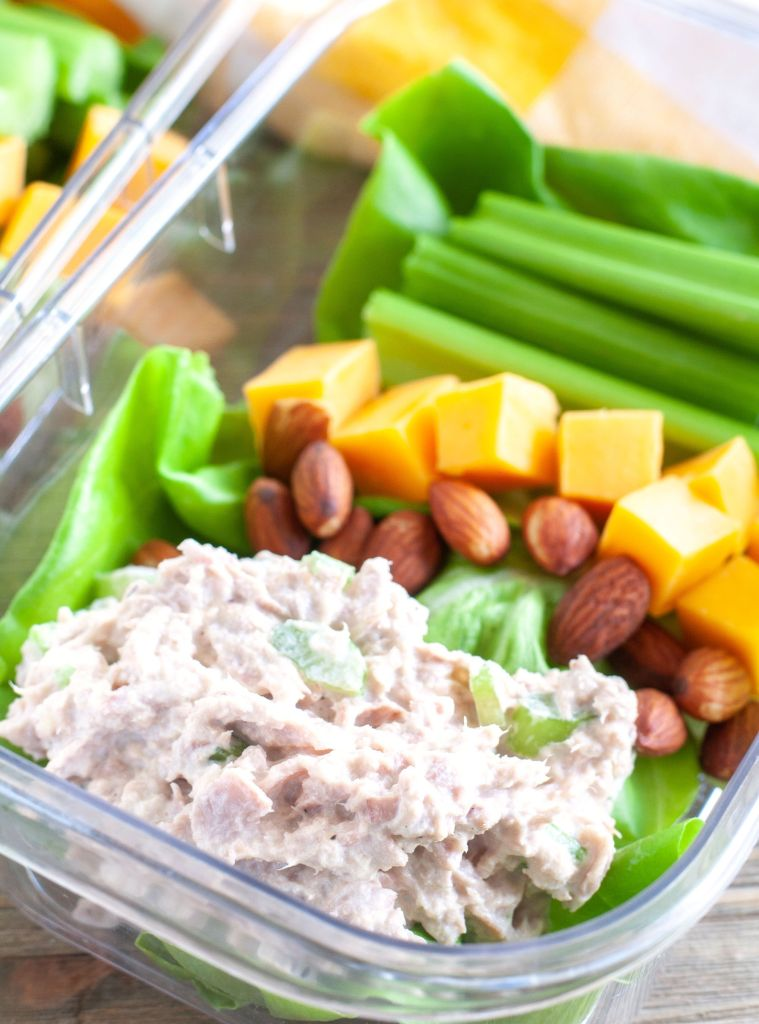Tuna Salad, almonds, cubed cheese and celery sticks in a meal prep container