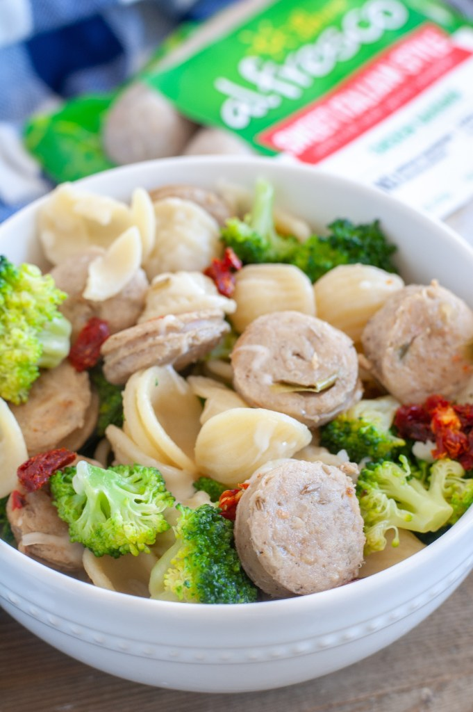 A bowl of pasta, broccoli and chicken sausage
