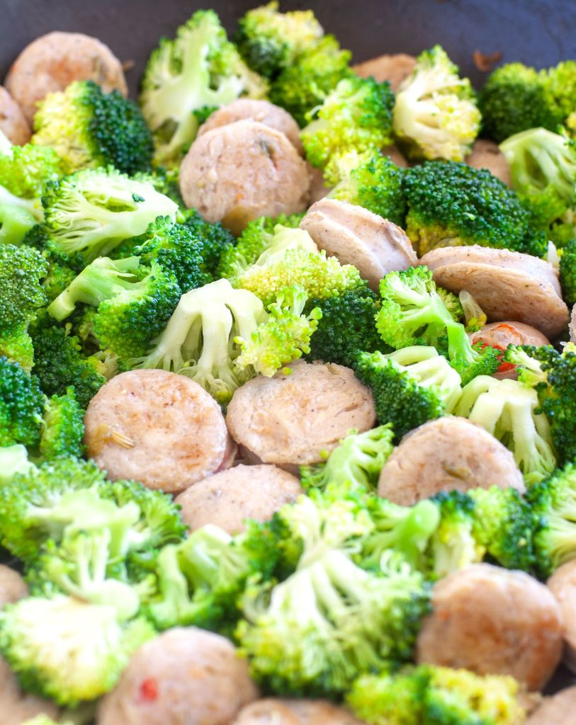 Chicken sausage and broccoli in a skillet