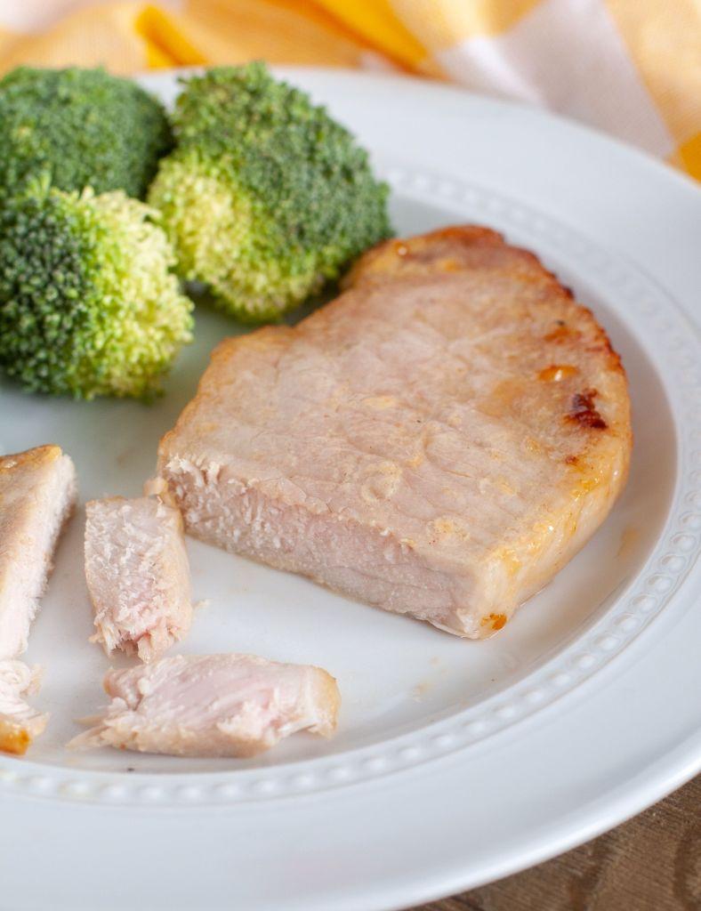 Pork Chop on a plate with broccoli