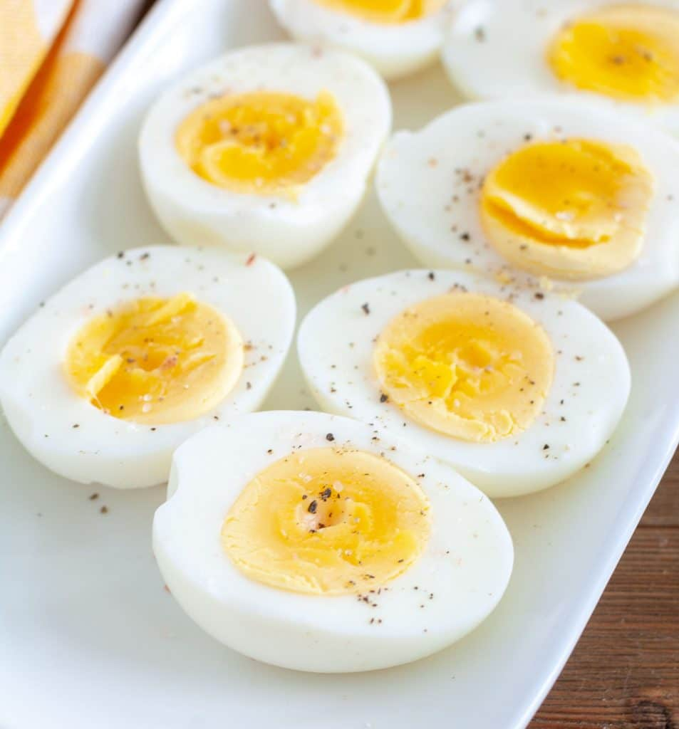 Air Fryer Hard Boiled Eggs cut in half on a white plate