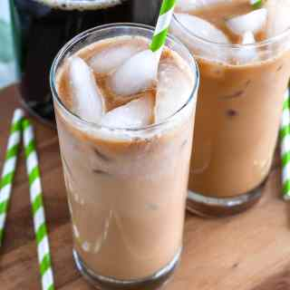 Iced latte in 2 glasses and carafe of coffee