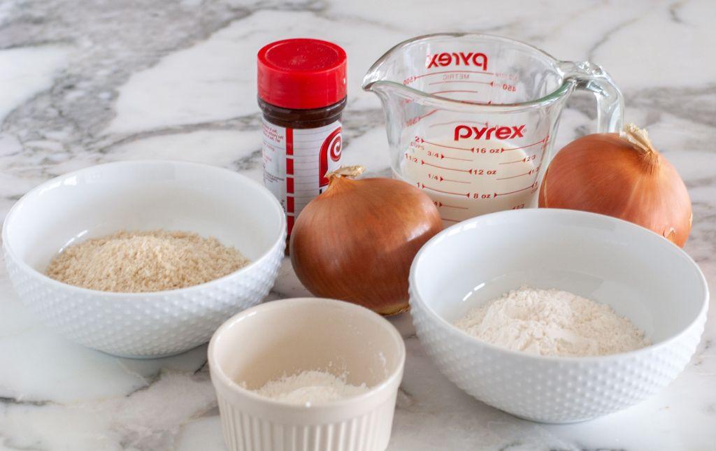 Bowl of flour, cornstarch, onion, milk, seasoning