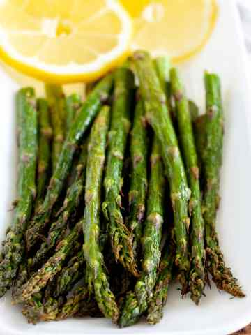 asparagus on plate with lemons