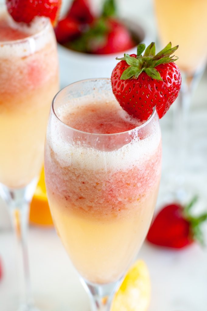 Glass with champagne and a strawberry.