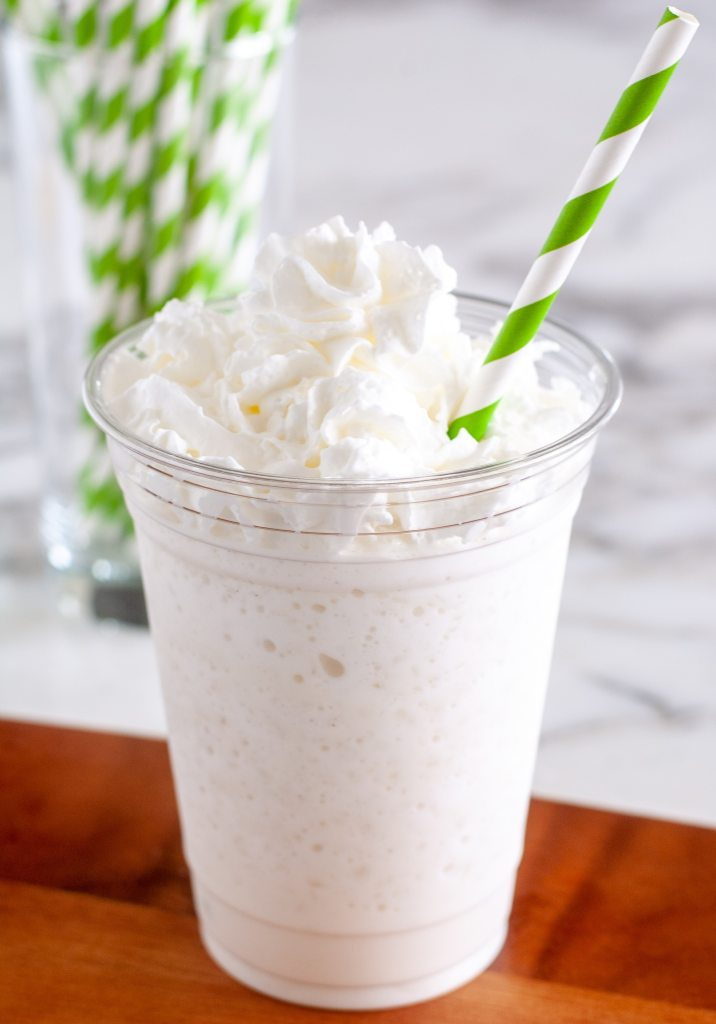 vanilla frappuccino in a glass with straw