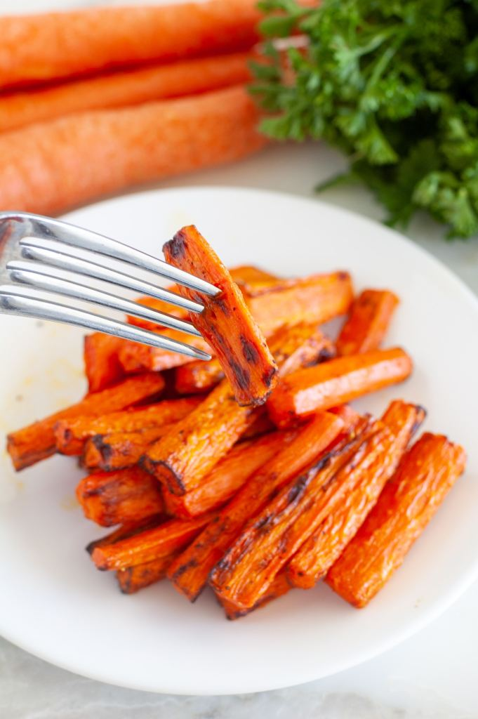Roasted carrots with a fork