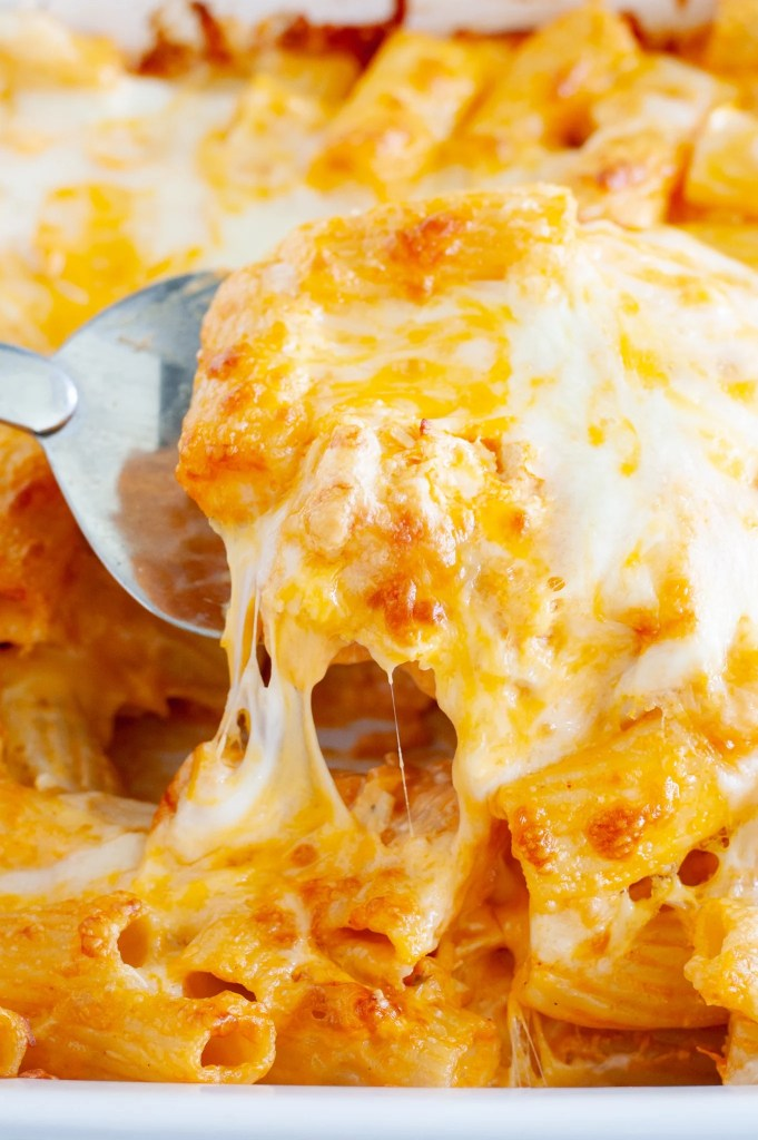 Chicken pasta bake with serving spoon