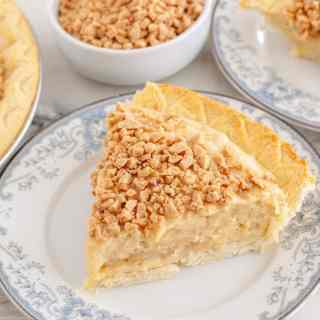 Slice of butterscotch pie on plate.