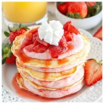 Stack of pancakes with strawberries.