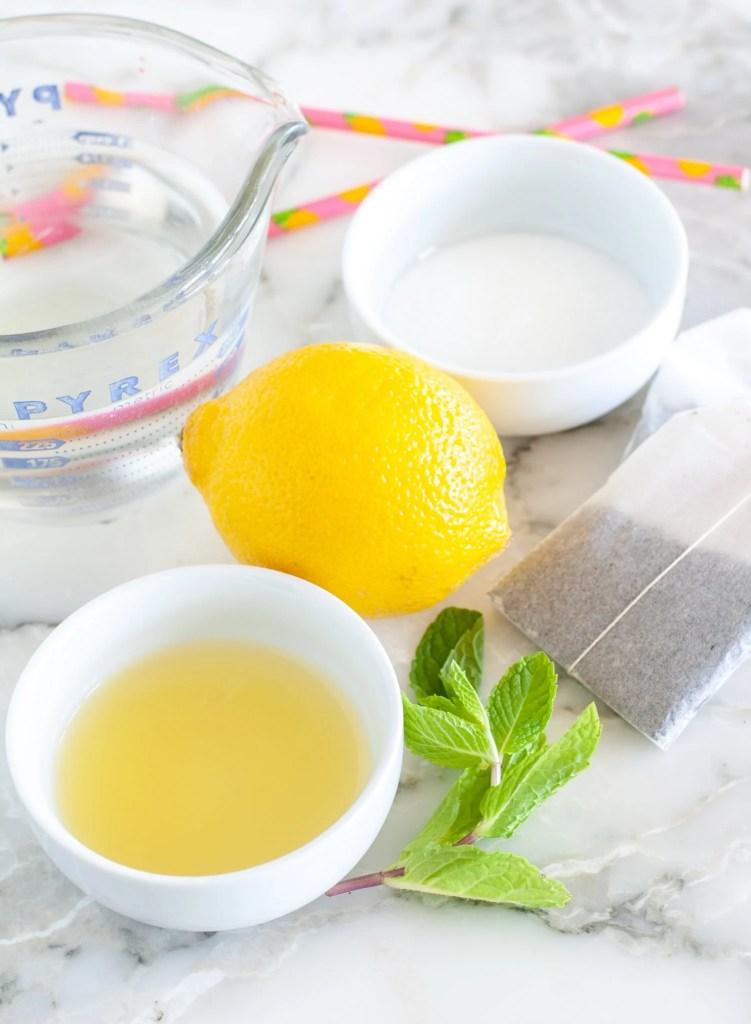Bowl of pineapple juice, lemon, mint leaves and sugar.