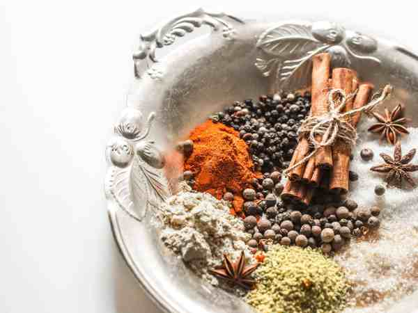 83957352 – a variety of oriental spices on a beautiful plate,isolated on white background, concept of spicy food and spices
