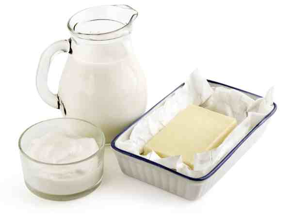 milk, butter and cream isolated on white background