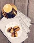 Hazelnut Kisses Biscuits/ Baci Di Dama On a White Fluted Plate, Grey Linen Napkins and Espresso