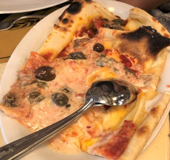 Plate of Filled Focaccia with Olives at Locanda Tortuga, on Food Tour in Genoa, Italy
