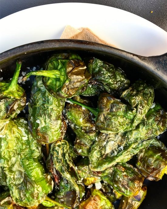 Padron Peppers in Cast Iron Skillet at Gambas Restaurant, Bristol, UK