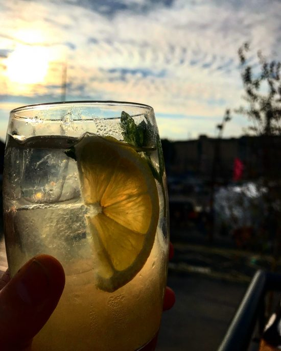 Sherry Cocktail In Front of Sunset at Gambas Restaurant, Bristol, UK
