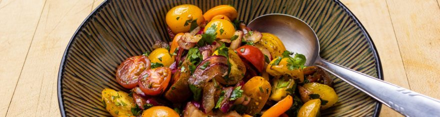 Tomato and onion salad as prepared by David Jackson on Food Over 50