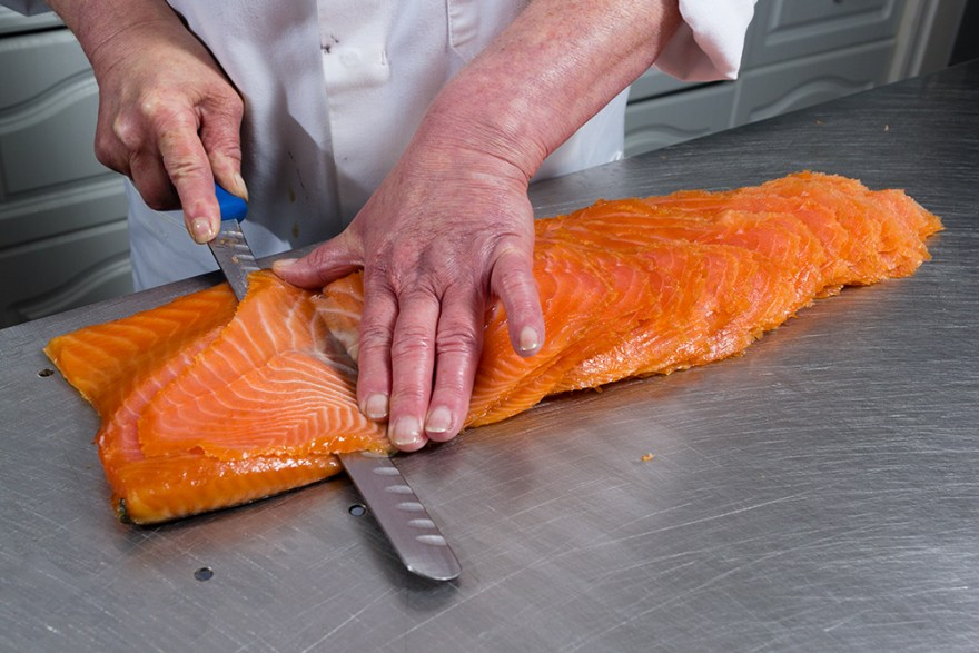 Smoked salmon being sliced at Uig Lodge in the Outer Hebrides of Scotland