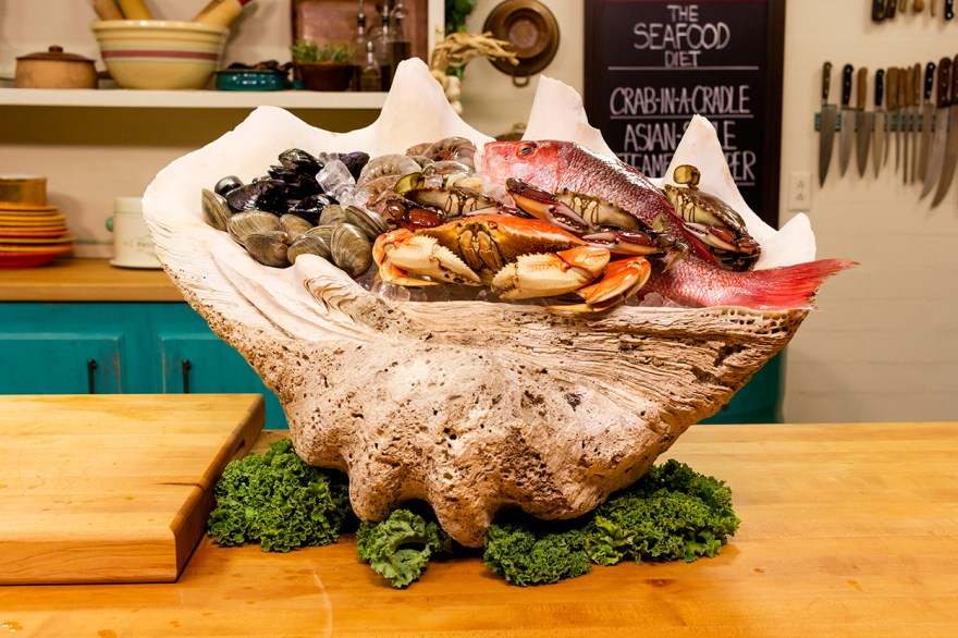 Seafood display in a giant clam shell from Food Over 50
