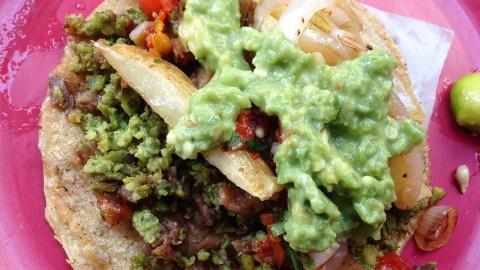 Green chorizo taco with guac