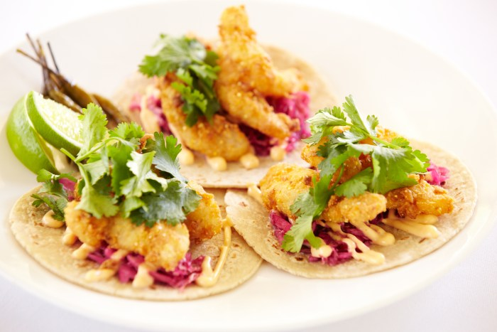 A house favorite, the crispy petrale sole tacos are topped with sweet and sour cabbage, cilantro, and spicy aioli. (Photo credit: Solage Calistoga)