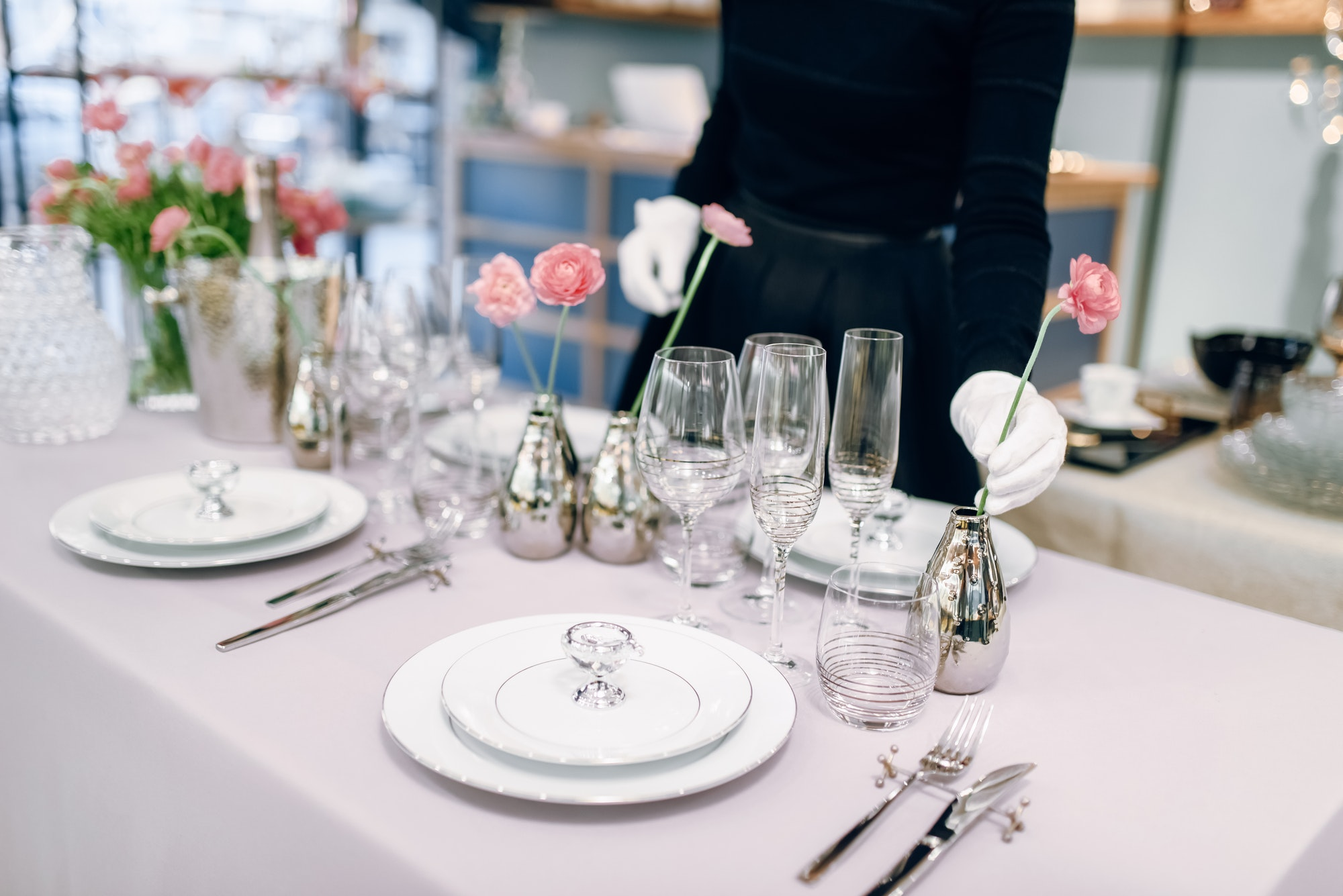 Waitress against empty tableware, table setting