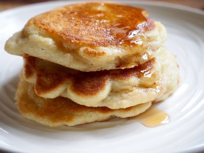 baking with coconut flour stack of fluffy pancakes with maple syrup