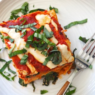 best ever paleo lasagna on plate with fresh basil