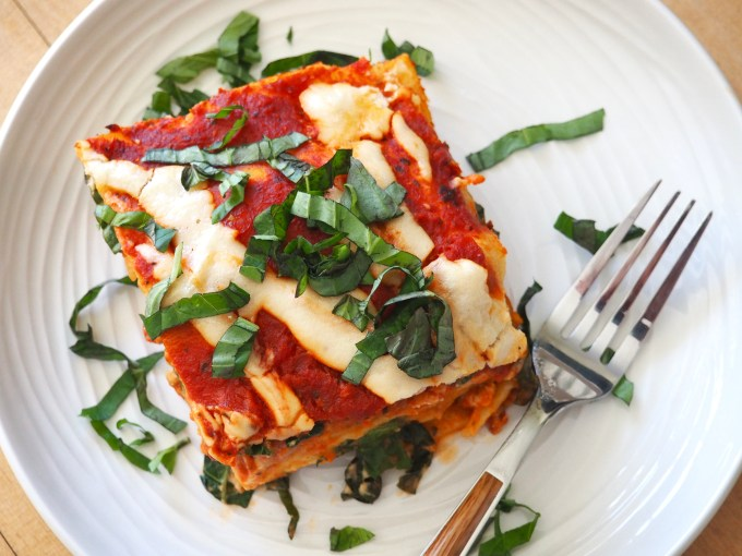 piece of best ever paleo lasagna with fresh basil