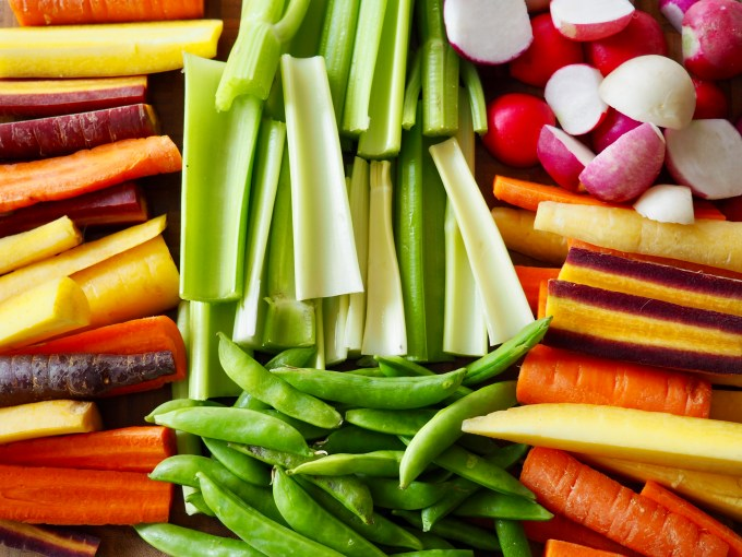 healthy meal prep with rainbow carrot sticks celery sticks easter egg radishes and sugar snap peas