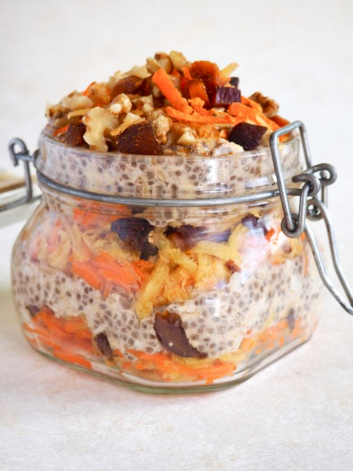 layered carrots, oats, chia seeds, walnuts, and dried apricots in a parfait jar