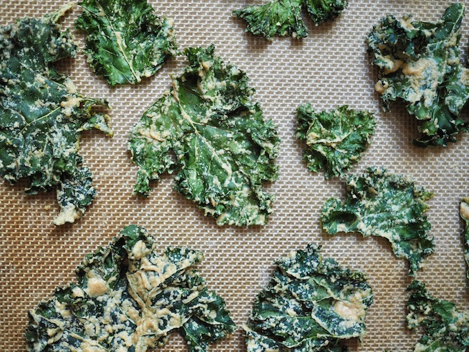 baked Easy Tahini Garlic Kale Chips on a baking mat