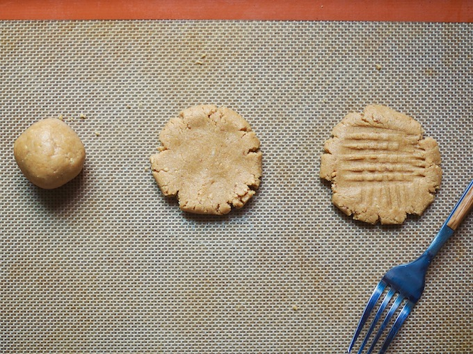 stages of making no-bake peanut butter cookies for ice cream sandwiches, rolled ball, pressed flat, and imprinted with fork
