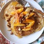 paleo, easy, and fluffy grain-free pancakes with peaches, walnuts, and maple syrup